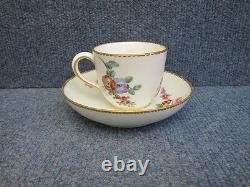SEVRES PORCELAIN CUP & SAUCER with flowers decorated and gilt border 18th cent