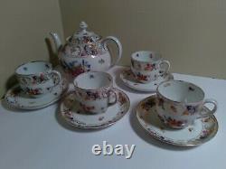 Schumann Dresden Bavaria Porcelain Teapot with 4 cups saucers