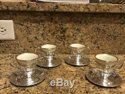 Set of 4 Antique Sterling Demitasse cup holders with saucers and porcelain cups